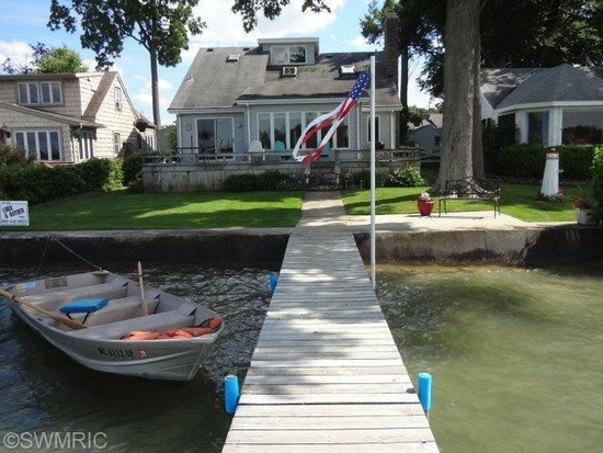 Diamond Lake Michigan lakefront home offered by Loux & Hayden Realty